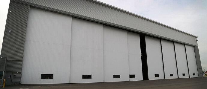 very-large-airplane-hangar-door-bottom-rolling-panel-door-well-bilt-industries